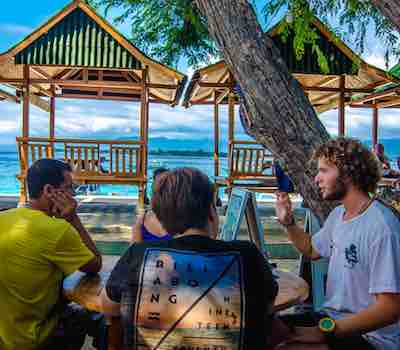 Dive briefings in front of the shop at Gili Meno.